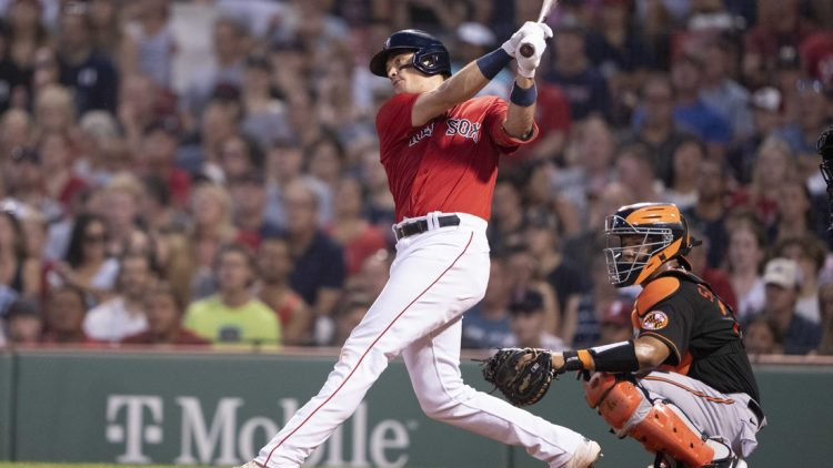 Aug 13, 2021; Boston, Massachusetts, USA; Boston Red Sox first baseman Bobby Dalbec (29) hits an RBI double during the second inning against the Baltimore Orioles at Fenway Park. Mandatory Credit: Gregory Fisher-USA TODAY Sports