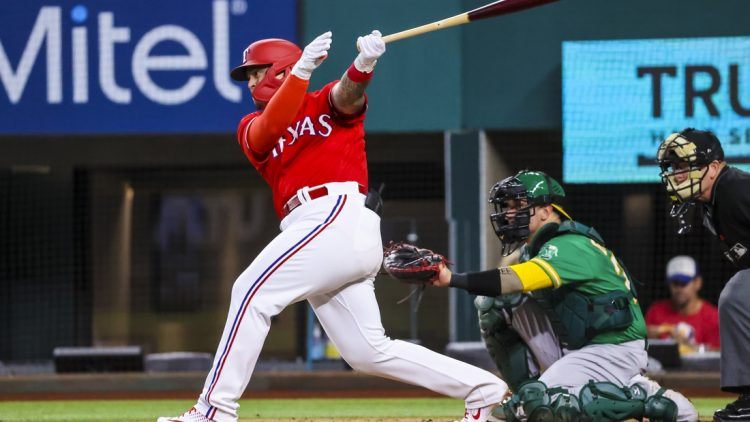 Aug 13, 2021; Arlington, Texas, USA;  Texas Rangers designated hitter Yohel Pozo (37) hits a single for his first major league hit during the second inning against the Oakland Athletics at Globe Life Field. Mandatory Credit: Kevin Jairaj-USA TODAY Sports