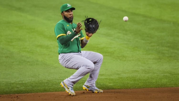 Aug 13, 2021; Arlington, Texas, USA;  Oakland Athletics shortstop Elvis Andrus (17) fields a ball during the game against the Texas Rangers at Globe Life Field. Mandatory Credit: Kevin Jairaj-USA TODAY Sports