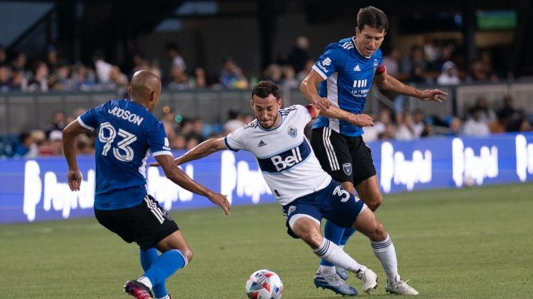 Aug 13, 2021; San Jose, California, USA; Vancouver Whitecaps midfielder Russell Teibert (31) fights for control of the ball against San Jose Earthquakes midfielder Judson (93) and defender Tanner Beason (15) during the first half at PayPal Park. Mandatory Credit: Stan Szeto-USA TODAY Sports