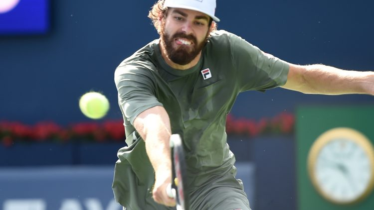 Aug 14, 2021; Toronto, Ontario, Canada;  Reilly Opelka of the United States plays a shot against Stefanos Tsiitsipas of Greece in the semi finals of the National Bank Open at Aviva Centre. Mandatory Credit: Dan Hamilton-USA TODAY Sports