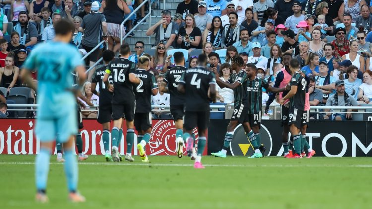 Aug 14, 2021; Saint Paul, MN, Saint Paul, MN, USA; Los Angeles Galaxy forward Kevin Cabral (9) celebrates with teammates after scoring a goal against Minnesota United in the first half at Allianz Field. Mandatory Credit: David Berding-USA TODAY Sports