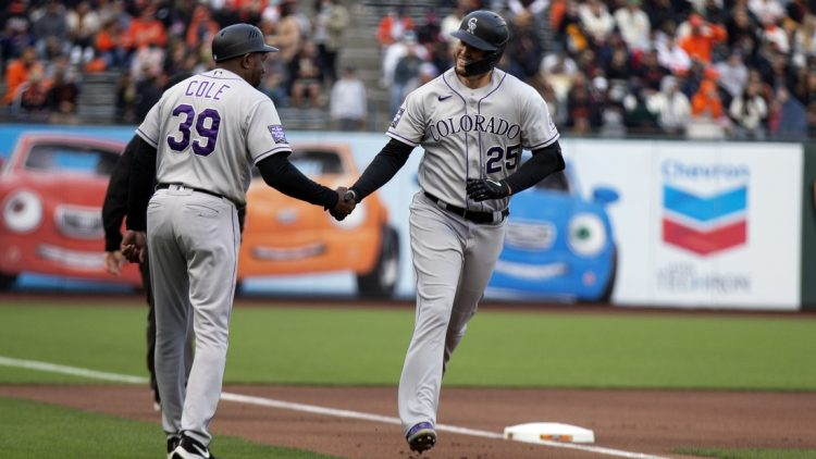 Aug 14, 2021; San Francisco, California, USA; Colorado Rockies first baseman C.J. Cron (25) celebrates with third base coach Stu Cole (39) after hitting a home run against San Francisco Giants starting pitcher Sammy Long (not pictured) during the first inning at Oracle Park. Mandatory Credit: D. Ross Cameron-USA TODAY Sports