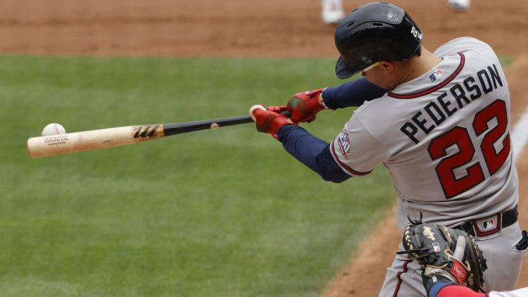 Aug 15, 2021; Washington, District of Columbia, USA; Atlanta Braves left fielder Joc Pederson (22) hits a double against the Washington Nationals in the second inning at Nationals Park. Mandatory Credit: Geoff Burke-USA TODAY Sports