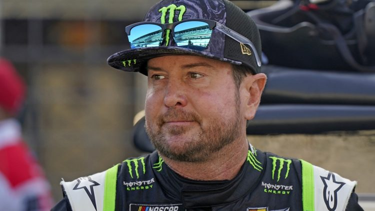 Aug 15, 2021; Speedway, Indiana, USA; NASCAR Cup Series driver Kurt Busch (1) looks on before the Verizon 200 at the Brickyard at Indianapolis Motor Speedway Road Course. Mandatory Credit: Mike Dinovo-USA TODAY Sports