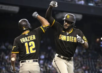 Aug 15, 2021; Phoenix, Arizona, USA; San Diego Padres right fielder Fernando Tatis Jr. (right) celebrates with Adam Frazier (12) after hitting a solo home run against the Arizona Diamondbacks in the first inning at Chase Field. Mandatory Credit: Rick Scuteri-USA TODAY Sports