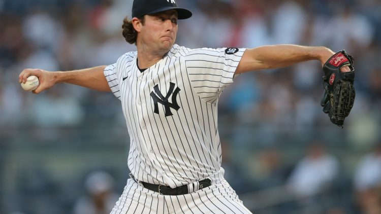 Aug 16, 2021; Bronx, New York, USA; New York Yankees starting pitcher Gerrit Cole (45) throws a pitch against the Los Angeles Angels during the first inning at Yankee Stadium. Mandatory Credit: Brad Penner-USA TODAY Sports