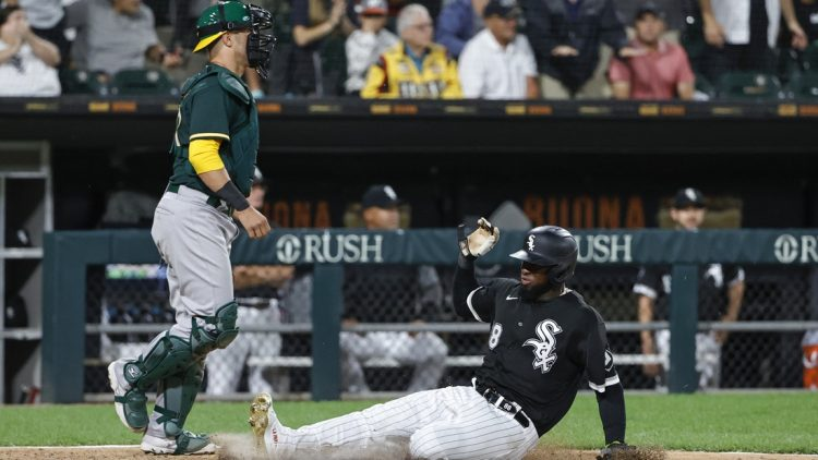 Aug 16, 2021; Chicago, Illinois, USA; Chicago White Sox center fielder Luis Robert (88) scores against the Oakland Athletics during the fourth inning at Guaranteed Rate Field. Mandatory Credit: Kamil Krzaczynski-USA TODAY Sports