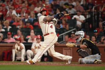 Aug 21, 2021; St. Louis, Missouri, USA; St. Louis Cardinals catcher Yadier Molina (4) hits an RBI single against the Pittsburgh Pirates during the sixth inning at Busch Stadium. Mandatory Credit: Joe Puetz-USA TODAY Sports