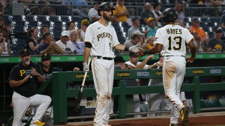 Aug 24, 2021; Pittsburgh, Pennsylvania, USA; Pittsburgh Pirates catcher Jacob Stallings (58) congratulates third baseman Ke'Bryan Hayes (13) after Hayes scored a run against the Arizona Diamondbacks during the third inning at PNC Park. Mandatory Credit: Charles LeClaire-USA TODAY Sports