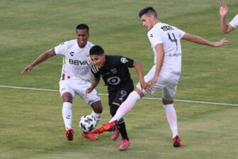 Aug 25, 2021; Los Angeles, CA, USA; Liga MX All-Stars defender Cesar Montes (4) defends against MLS All-Stars forward Raul Ruidiaz (9) in the first half during the 2021 MLS All-Star Game at Banc of California Stadium. Mandatory Credit: Orlando Ramirez-USA TODAY Sports
