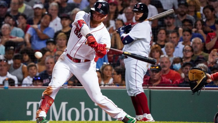 Aug 26, 2021; Boston, Massachusetts, USA; Boston Red Sox left fielder Alex Verdugo (99) drives in a run with a single against the Minnesota Twins in the third inning at Fenway Park. Mandatory Credit: David Butler II-USA TODAY Sports