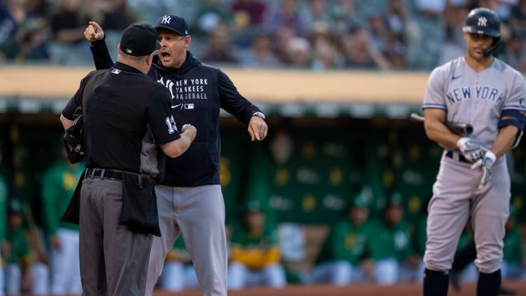 Aug 26, 2021; Oakland, California, USA;  New York Yankees manager Aaron Boone (17) argues with umpire Todd Tichenor (13) after being ejected from the game against the Oakland Athletics during the second inning at RingCentral Coliseum. Mandatory Credit: Neville E. Guard-USA TODAY Sports