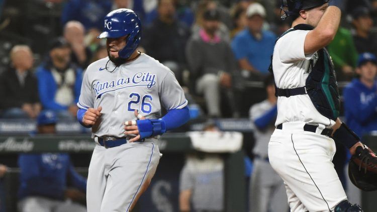 Aug 26, 2021; Seattle, Washington, USA; Kansas City Royals third baseman Emmanuel Rivera (26) scores from second base against the Seattle Mariners in the seventh inning at T-Mobile Park. Mandatory Credit: James Snook-USA TODAY Sports