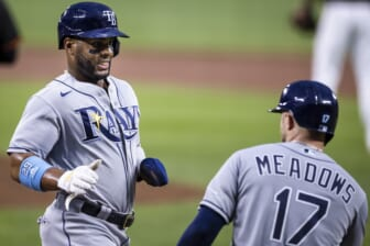Aug 27, 2021; Baltimore, Maryland, USA; Tampa Bay Rays first baseman Yandy Diaz (2) celebrates with left fielder Austin Meadows (17) after scoring against the Baltimore Orioles during the first inning at Oriole Park at Camden Yards. Mandatory Credit: Scott Taetsch-USA TODAY Sports