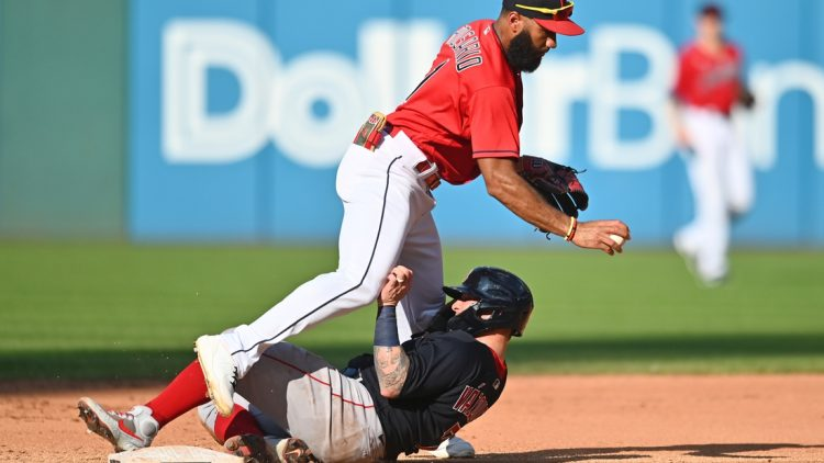 Aug 28, 2021; Cleveland, Ohio, USA; Cleveland Indians shortstop Amed Rosario (1) forces out Boston Red Sox catcher Christian Vazquez (7) during the fifth inning at Progressive Field. Mandatory Credit: Ken Blaze-USA TODAY Sports