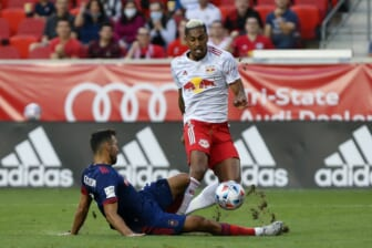 Aug 28, 2021; Harrison, New Jersey, USA;  Chicago Fire defender Jonathan Bornstein (3) slide tackles the ball away from New York Red Bulls forward Fabio (9) during the first half at Red Bull Arena. Mandatory Credit: Tom Horak-USA TODAY Sports