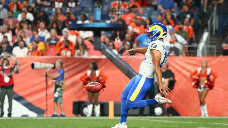 Aug 28, 2021; Denver, Colorado, USA; Los Angeles Rams punter Corey Bojorquez (13) punts the ball against the Denver Broncos during the second quarter at Empower Field at Mile High. Mandatory Credit: C. Morgan Engel-USA TODAY Sports