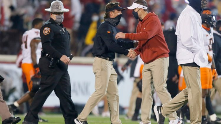 Oklahoma coach Lincoln Riley, right, greets Oklahoma State coach Mike Gundy after last year's Bedlam game in Norman.  cover