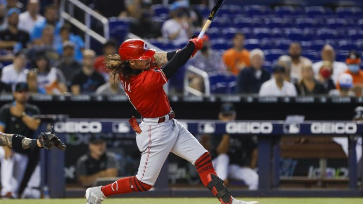 Aug 29, 2021; Miami, Florida, USA; Cincinnati Reds third baseman Jonathan India (6) connects for a base hit against the Miami Marlins during the first inning at loanDepot Park. Mandatory Credit: Sam Navarro-USA TODAY Sports