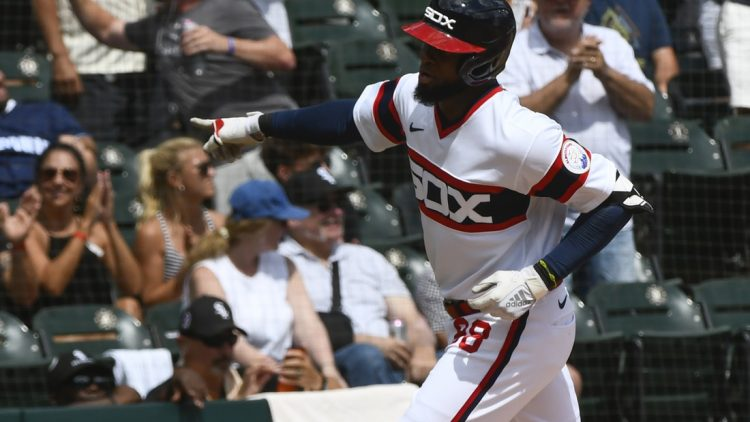 Aug 29, 2021; Chicago, Illinois, USA;  Chicago White Sox center fielder Luis Robert (88) after he hits a home run against the Chicago Cubs during the first inning at Guaranteed Rate Field. Mandatory Credit: Matt Marton-USA TODAY Sports