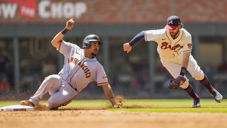 Aug 29, 2021; Cumberland, Georgia, USA; San Francisco Giants right fielder LaMonte Wade Jr. (31) steals second base ahead of a tag by Atlanta Braves shortstop Dansby Swanson (7) during the third inning at Truist Park. Mandatory Credit: Dale Zanine-USA TODAY Sports