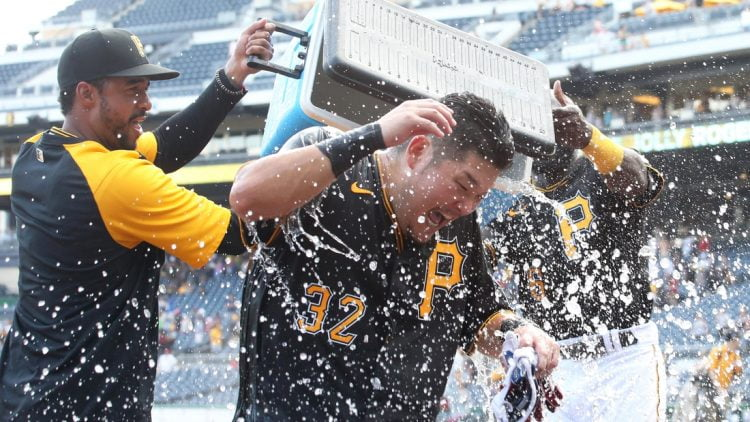 Aug 29, 2021; Pittsburgh, Pennsylvania, USA;  Pittsburgh Pirates relief pitcher Duane Underwood Jr. (left) and left fielder Anthony Alford (right) dump ice water on right fielder Yoshi Tsutsugo (32) after Tsuitsugo hit a game winning walk-off three run home run to defeat the St. Louis Cardinals at PNC Park. The Pirates won 4-3. Mandatory Credit: Charles LeClaire-USA TODAY Sports