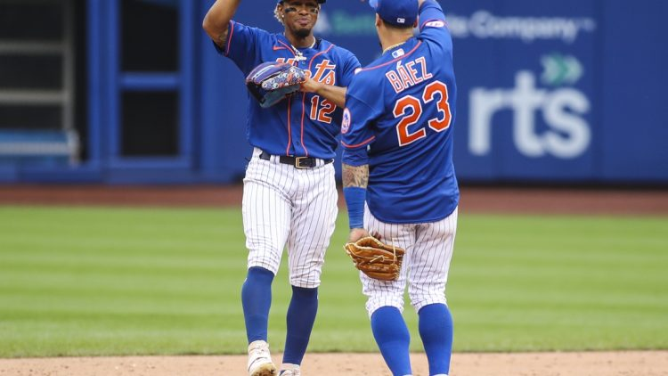 Aug 29, 2021; New York City, New York, USA; New York Mets shortstop Francisco Lindor (12) and second baseman Javier Baez (23) celebrate after defeating the Washington Nationals 9-4 at Citi Field. Mandatory Credit: Wendell Cruz-USA TODAY Sports