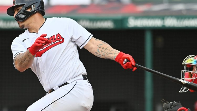 Aug 29, 2021; Cleveland, Ohio, USA; Cleveland Indians catcher Wilson Ramos (40) hits an RBI single during the sixth inning against the Boston Red Sox at Progressive Field. Mandatory Credit: Ken Blaze-USA TODAY Sports