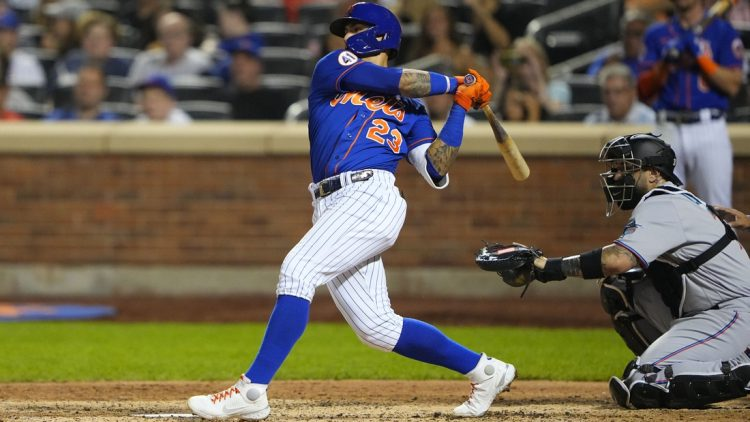 Aug 31, 2021; New York City, New York, USA; New York Mets shortstop Javier Baez (23) hits a single against the Miami Marlins during the fourth inning at Citi Field. Mandatory Credit: Gregory Fisher-USA TODAY Sports