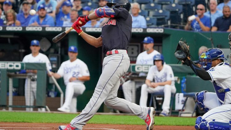 Aug 31, 2021; Kansas City, Missouri, USA; Cleveland Indians shortstop Amed Rosario (1) connects for a solo inside the park home run against the Kansas City Royals in the first inning at Kauffman Stadium. Mandatory Credit: Denny Medley-USA TODAY Sports