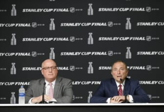 May 27, 2019; Boston, MA, USA; NHL commissioner Gary Bettman (right) and deputy commissioner Bill Daly (left) at a press conference before game one of the 2019 Stanley Cup Final between the Boston Bruins and the St. Louis Blues at TD Garden. Mandatory Credit: Winslow Townson-USA TODAY Sports