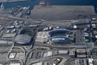 Aug 29, 2019; Seattle, WA, USA; General overall aerial view of T-Mobile Park (left) and CenturyLink Field. The retractable roof T-Mobile Park, opened in 1999 and formerly known as Safeco Field, is the home of the Seattle Mariners of the MLB. CenturyLink Field was opened in 2002 and was named Seahawks Stadium (2002-2004) and Qwest Field (2004-11). It is the home of the Seattle Seahawks of the NFL and Seattle Sounders of the MLS.Mandatory Credit: Kirby Lee-USA TODAY Sports