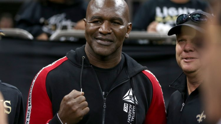 Nov 10, 2019; New Orleans, LA, USA; Former heavyweight boxing champion Evander Holyfield poses for pictures before a game between the New Orleans Saints and the Atlanta Falcons at the Mercedes-Benz Superdome. Mandatory Credit: Chuck Cook-USA TODAY Sports