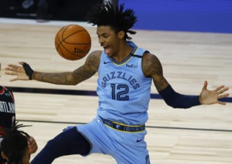 Aug 15, 2020; Lake Buena Vista, Florida, USA; Ja Morant #12 of the Memphis Grizzlies reacts after a dunk against the Portland Trail Blazers during the fourth quarter in the Western Conference play-in game one at The Field House. Mandatory Credit: Kevin C. Cox/Pool Photo-USA TODAY Sports