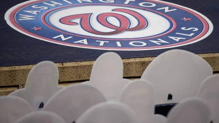 Sep 11, 2020; Washington, District of Columbia, USA; A Washington Nationals logo is seen in front of cutouts of fans in the seats during the third inning of the game between the Washington Nationals and the Atlanta Braves at Nationals Park. Mandatory Credit: Scott Taetsch-USA TODAY Sports