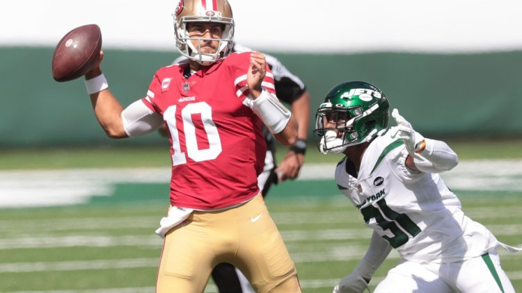 Sep 20, 2020; East Rutherford, New Jersey, USA; San Francisco 49ers quarterback Jimmy Garoppolo (10) throws a pass during the first quarter as New York Jets cornerback Blessuan Austin (31) defends at MetLife Stadium. Mandatory Credit: Vincent Carchietta-USA TODAY Sports