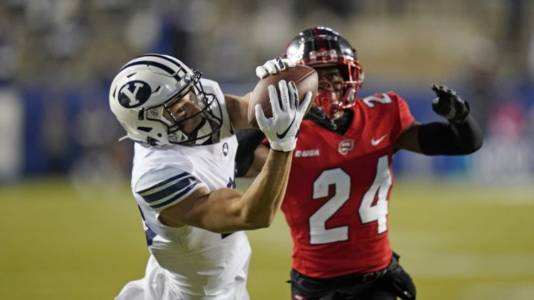 Oct 31, 2020; Provo, UT, USA; BYU wide receiver Gunner Romney (left) catches a pass against Western Kentucky defensive back Roger Cray (24) in the first half of an NCAA college football game Saturday, Oct. 31, 2020, in Provo, Utah. Mandatory Credit: Rick Bowmer/Pool Photo-USA TODAY Sports