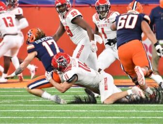 Nov 28, 2020; Syracuse, New York, USA; North Carolina State Wolfpack linebacker Payton Wilson (11) sacks Syracuse Orange quarterback Rex Culpepper (17) in the fourth quarter at the Carrier Dome. Mandatory Credit: Mark Konezny-USA TODAY Sports