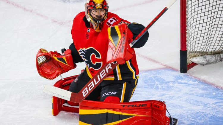 Apr 23, 2021; Calgary, Alberta, CAN; Calgary Flames goaltender Louis Domingue (70) guards his net during the warmup period against the Montreal Canadiens at Scotiabank Saddledome. Mandatory Credit: Sergei Belski-USA TODAY Sports