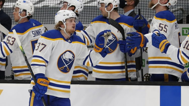 Apr 29, 2021; Boston, Massachusetts, USA; Buffalo Sabres center Casey Mittelstadt (37) celebrates with the bench after scoring against the Boston Bruins during the first period at TD Garden. Mandatory Credit: Winslow Townson-USA TODAY Sports