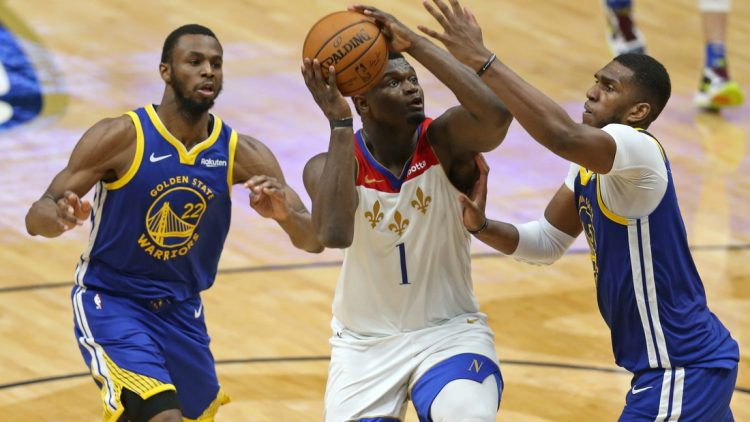 May 4, 2021; New Orleans, Louisiana, USA; New Orleans Pelicans forward Zion Williamson (1) drives on  Golden State Warriors forward Kevon Looney (5) in the third quarter at the Smoothie King Center. Mandatory Credit: Chuck Cook-USA TODAY Sports