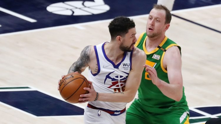 May 7, 2021; Salt Lake City, Utah, USA; Denver Nuggets guard Austin Rivers (25) looks to pass the ball while defended by Utah Jazz guard Joe Ingles (2) in the first quarter at Vivint Arena. Mandatory Credit: Rob Gray-USA TODAY Sports