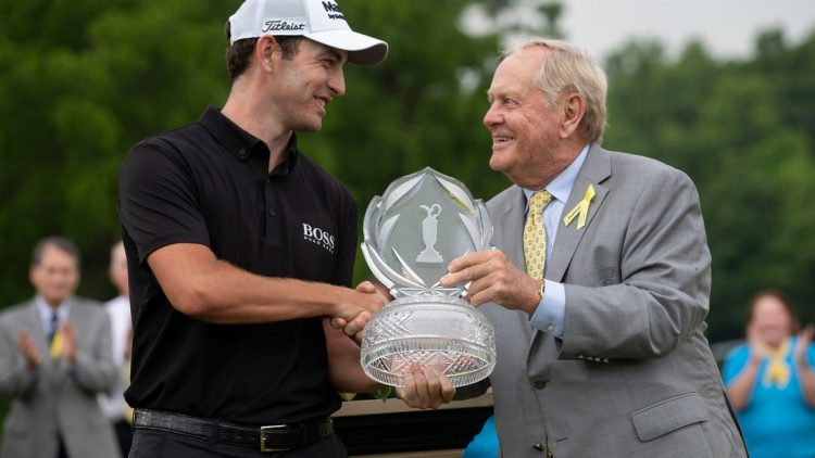 Patrick Cantlay receives the trophy for winning the Memorial Tournament from Jack Nicklaus following his playoff win over Collin Morikawa at Muirfield Village Golf Club in Dublin, Ohio on Sunday, June 6, 2021.  The Memorial Tournament Pga Golf