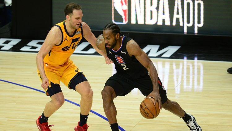 Jun 14, 2021; Los Angeles, California, USA; Los Angeles Clippers forward Kawhi Leonard (2) moves the ball against Utah Jazz forward Bojan Bogdanovic (44) during the second half in game four in the second round of the 2021 NBA Playoffs. at Staples Center. Mandatory Credit: Gary A. Vasquez-USA TODAY Sports