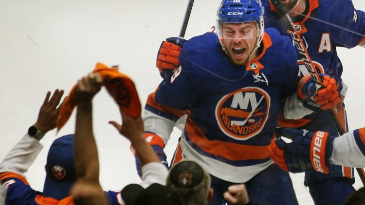 Jun 23, 2021; Uniondale, New York, USA; New York Islanders left wing Anthony Beauvillier (18) reacts after scoring the game winning goal against the Tampa Bay Lightning during overtime in game six of the 2021 Stanley Cup Semifinals at Nassau Veterans Memorial Coliseum. Mandatory Credit: Andy Marlin-USA TODAY Sports