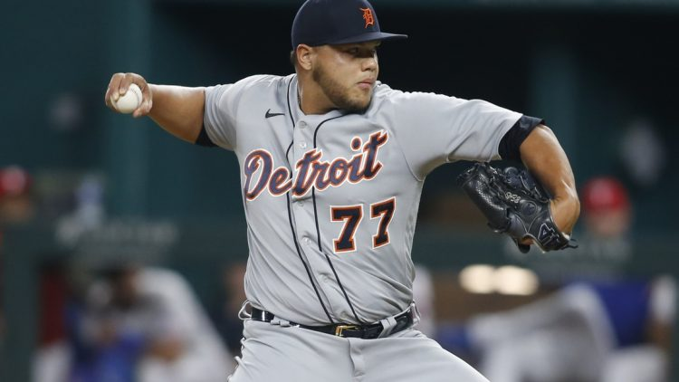 Jul 6, 2021; Arlington, Texas, USA; Detroit Tigers relief pitcher Joe Jimenez (77) pitches in the seventh inning against the Texas Rangers at Globe Life Field. Mandatory Credit: Tim Heitman-USA TODAY Sports