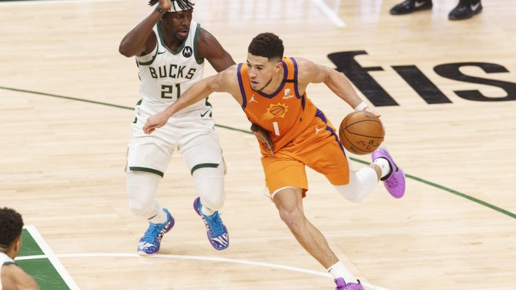 Jul 14, 2021; Milwaukee, Wisconsin, USA; Phoenix Suns guard Devin Booker (1) during game four of the 2021 NBA Finals against the Milwaukee Bucks at Fiserv Forum. Mandatory Credit: Jeff Hanisch-USA TODAY Sports