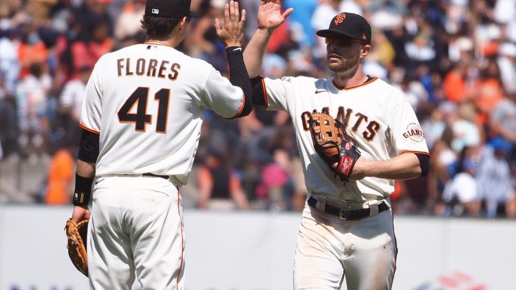 Jul 29, 2021; San Francisco, California, USA; San Francisco Giants third baseman Wilmer Flores (41) celebrates with left fielder Austin Slater (13) after a win against the Los Angeles Dodgers at Oracle Park. Mandatory Credit: Kelley L Cox-USA TODAY Sports