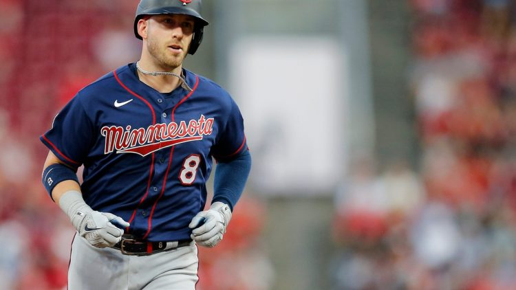 Minnesota Twins catcher Mitch Garver (8) runs the bases on a three-run go-ahead home run in the fifth inning of the MLB Interleague game between the Cincinnati Reds and the Minnesota Twins at Great American Ball Park in downtown Cincinnati on Tuesday, Aug. 3, 2021.  Minnesota Twins At Cincinnati Reds